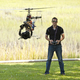 Man controlling helicopter drone, UAV with SLR camera attached. - PhotoDune Item for Sale