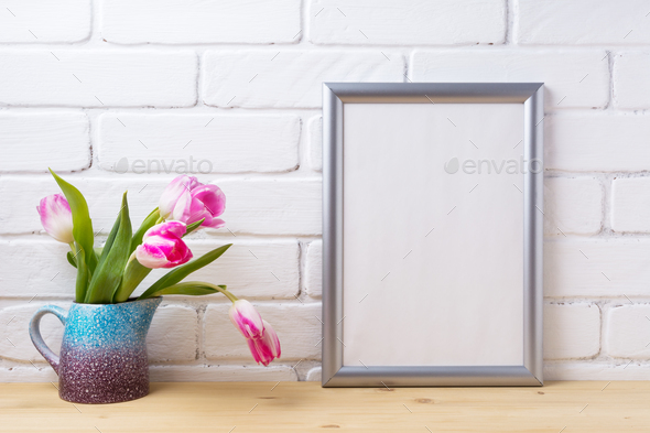 Silver frame mockup with pink tulip in purple blue vase - Stock Photo - Images
