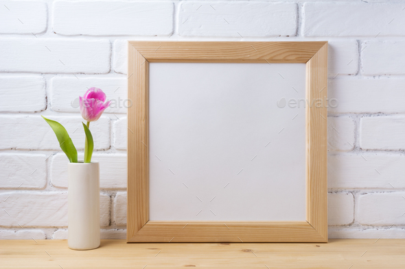 Wooden square frame mockup with pink tulip - Stock Photo - Images