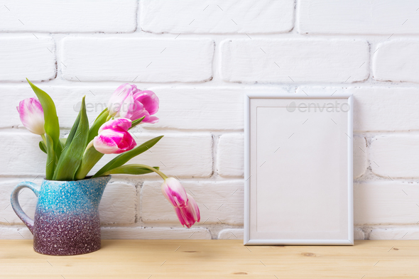White small frame mockup with pink tulip in purple blue vase - Stock Photo - Images