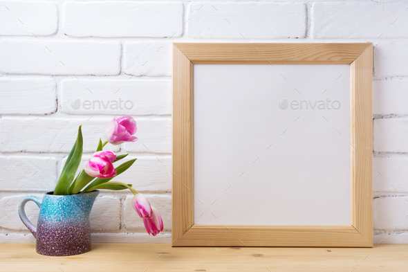 Wooden square frame mockup with pink tulip in purple blue vase - Stock Photo - Images