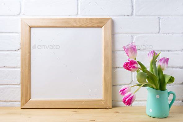 Wooden square frame mockup with pink tulip in mint pitcher vase - Stock Photo - Images