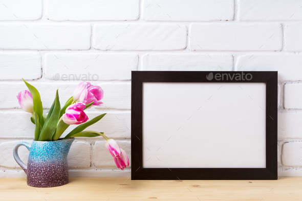 Black brown  landscape frame mockup with pink tulip in purple bl - Stock Photo - Images