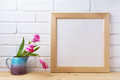 Wooden square frame mockup with pink tulip in purple blue vase - PhotoDune Item for Sale