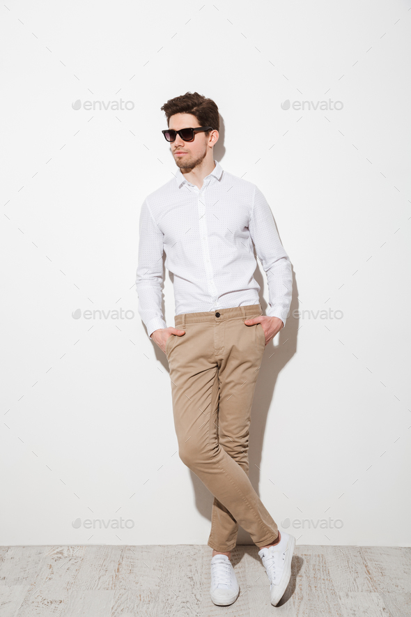 Full length picture of modern calm guy dressed in casual clothin - Stock Photo - Images