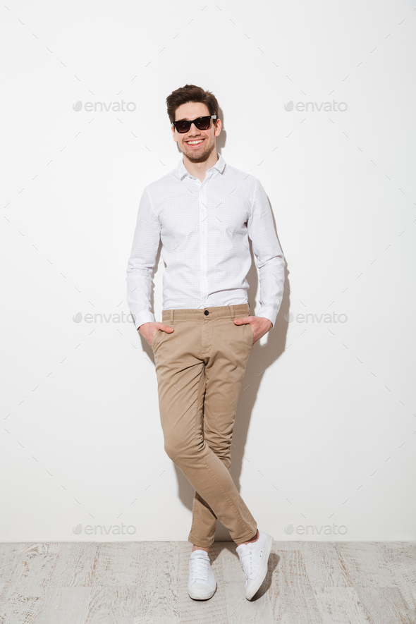 Full length photo of handsome guy dressed in casual clothing and - Stock Photo - Images