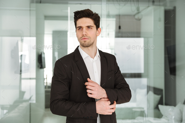 Serious young businessman - Stock Photo - Images