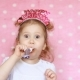 A Sweet Little Girl Blowing Horn Party, Smile, Have Fun, Laugh and Celebrate Happy Birthday - VideoHive Item for Sale