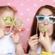 Mother and Daughter Dress Glasses and Blowing Horns. The Concept of a Holiday, Party, Celebrate - VideoHive Item for Sale
