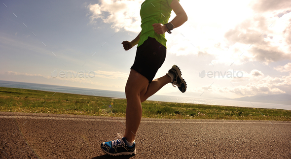 Runner running on country road - Stock Photo - Images