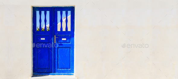 Blue door on a whitewashed wall - Cyclades, Greece - Stock Photo - Images