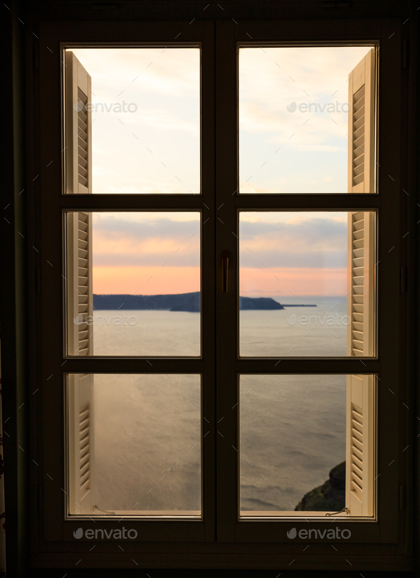 Beautiful sunset over sea water - window view - Stock Photo - Images