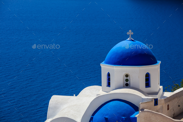 White church with blue dome in Santorini, Greece - Stock Photo - Images