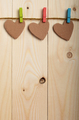 Handmade paper hearts hanging on clothesline over wood boards - PhotoDune Item for Sale