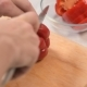 Man's Hand Gently and Slowly Cuts Red Sweet Pepper into Slices with a Knife - VideoHive Item for Sale