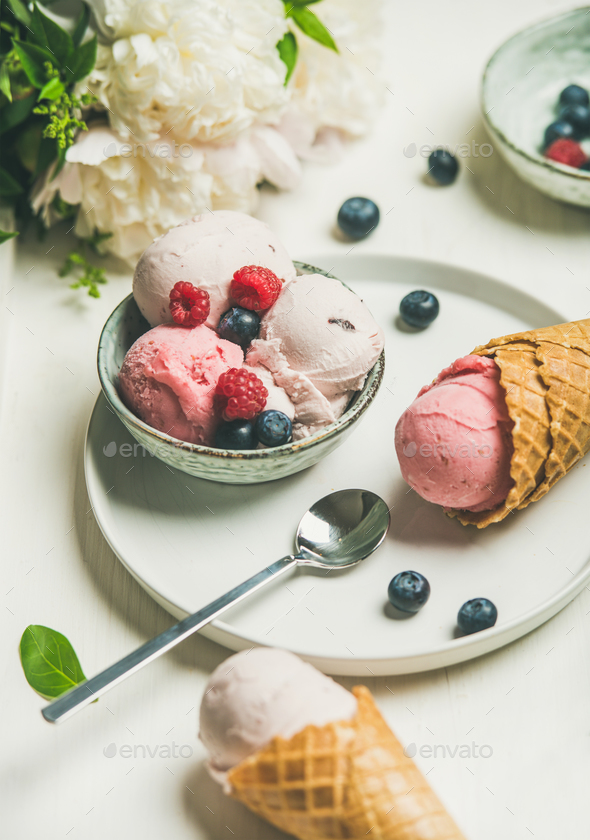 Pink strawberry and coconut ice cream scoops in bowl - Stock Photo - Images