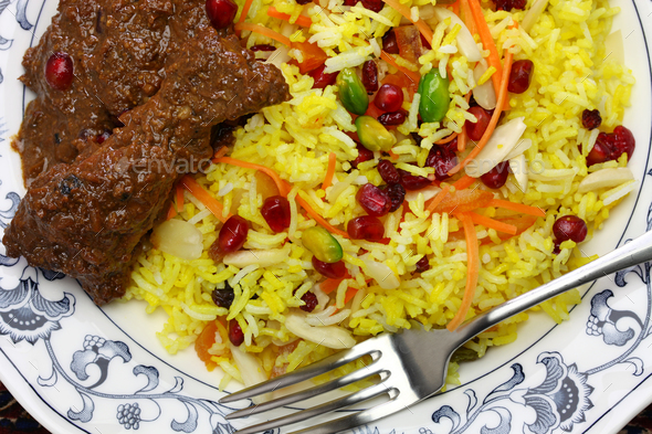 iranian cuisine, persian jeweled rice and chicken fesenjan - Stock Photo - Images