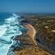 Aerial View of Rocky Coastline at Atlantic Ocean in Algarve Region, Portugal - VideoHive Item for Sale