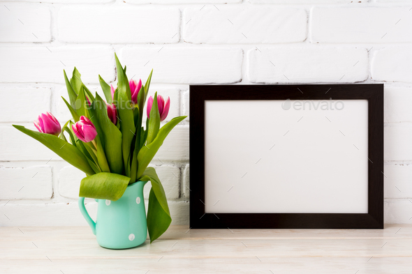 Black brown  landscape frame mockup with magenta tulips in mint - Stock Photo - Images