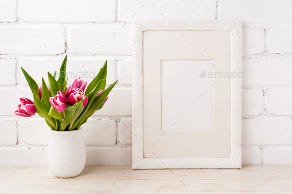 White frame mockup with magenta pink tulip in the flower pot - Stock Photo - Images