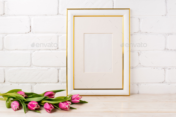 Gold decorated frame mockup with magenta tulips bouquet - Stock Photo - Images