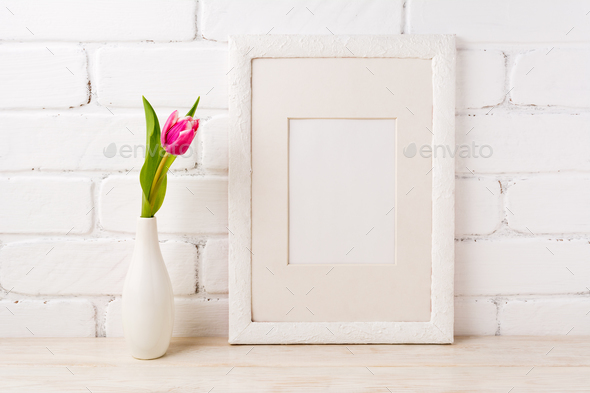 White frame mockup with magenta pink tulips - Stock Photo - Images