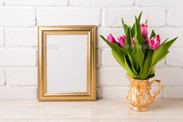 Golden frame mockup with magenta pink tulips in golden vase - Stock Photo - Images