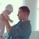 Dad Holds His Child in His Arms and Talks To Him - VideoHive Item for Sale