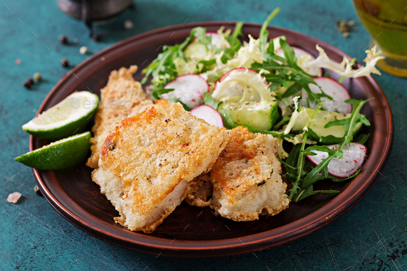 Fried white fish fillet and cucumber and radish salad - Stock Photo - Images