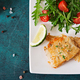 Fried white fish fillets and tomato salad with arugula. Top view - PhotoDune Item for Sale