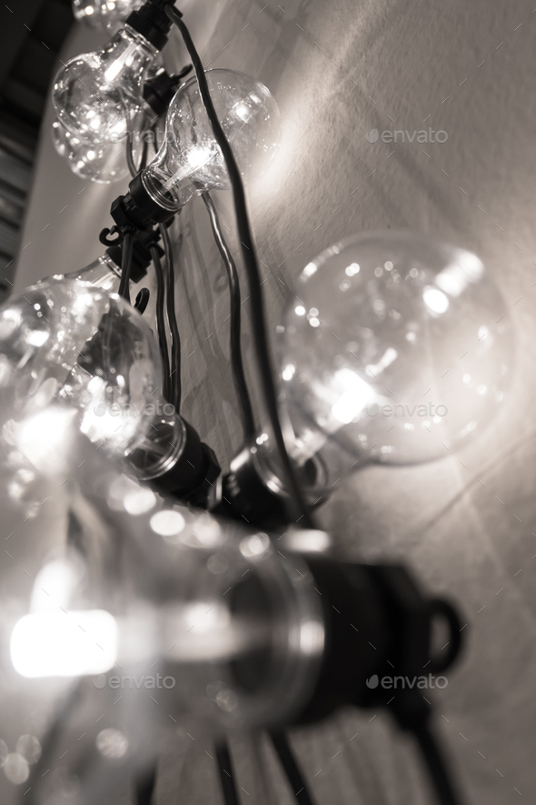 Vintage style light bulbs hanging from the wall - Stock Photo - Images