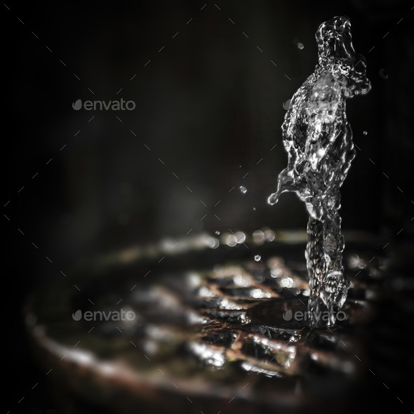 Water splash freeze motion as human figure - Stock Photo - Images