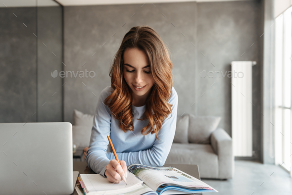 Portrait of a smiling young woman - Stock Photo - Images