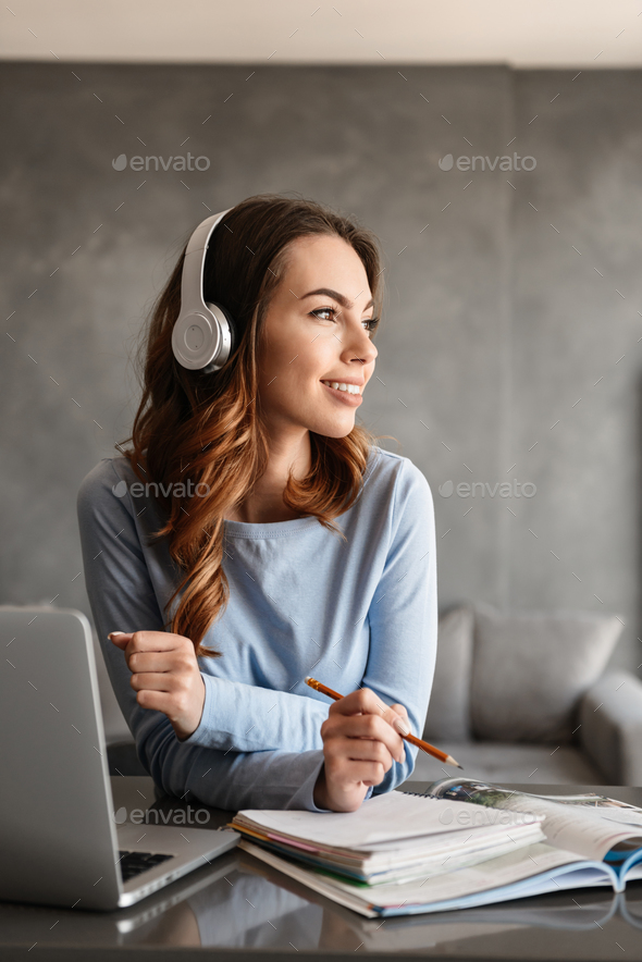Portrait of a pretty young woman in headphones - Stock Photo - Images