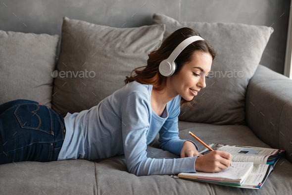 Portrait of a lovely young woman in headphones - Stock Photo - Images