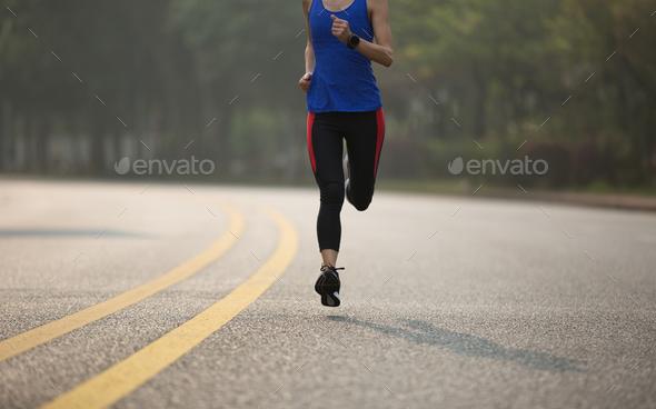 Runner running on street - Stock Photo - Images