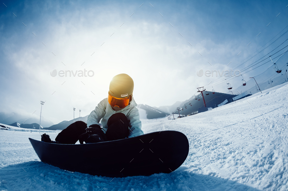 Snowboarder at ski resort - Stock Photo - Images