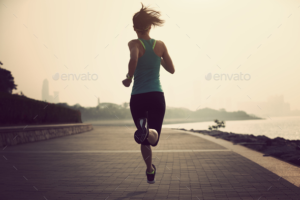 Fitness woman running on seaside - Stock Photo - Images
