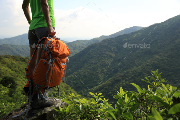 Hiker with backpack in the nature - Stock Photo - Images
