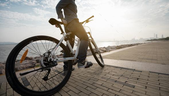 Riding bike on seaside city - Stock Photo - Images