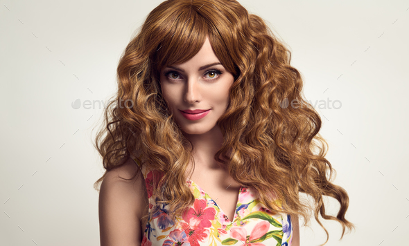 Gorgeous girl with Long and Shiny Curly Hair - Stock Photo - Images