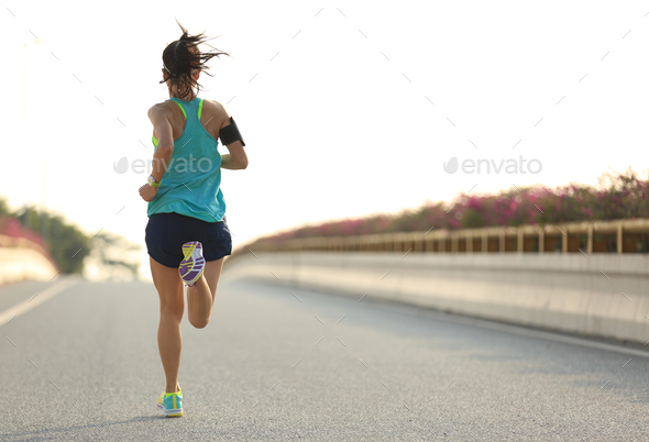 Fitness woman running on city street - Stock Photo - Images