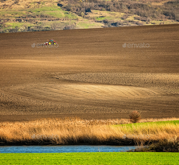 Tractor on the Field - Stock Photo - Images