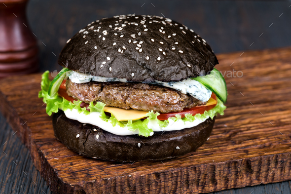 Burger on a wooden board - Stock Photo - Images