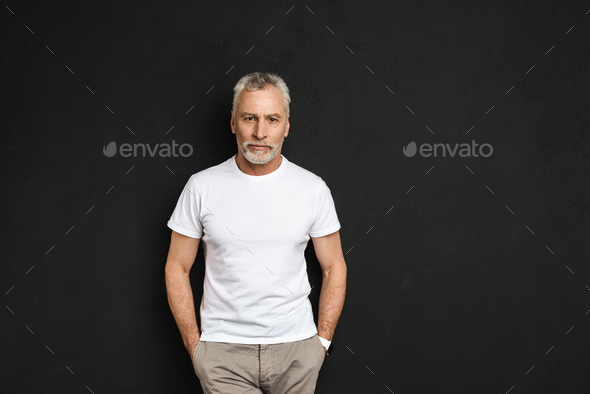 Handsome mature old man standing isolated - Stock Photo - Images