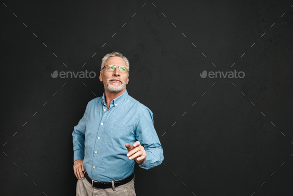 Portrait of elderly man 70s with grey hair and beard wearing for - Stock Photo - Images