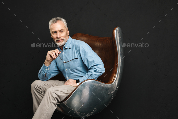 Image of businesslike gentleman 50s with grey hair and beard in - Stock Photo - Images