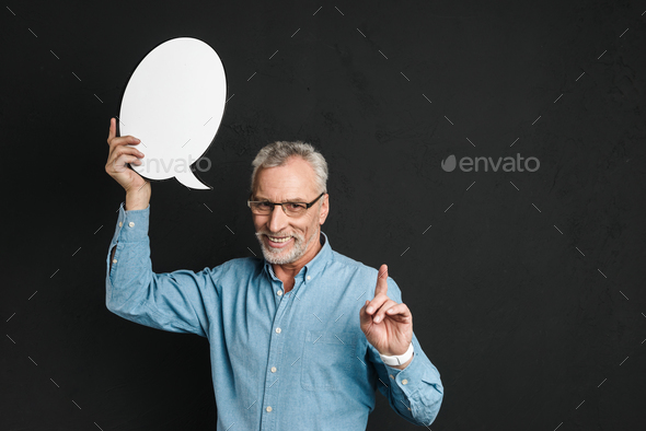 Portrait of a happy mature man dressed in shirt - Stock Photo - Images