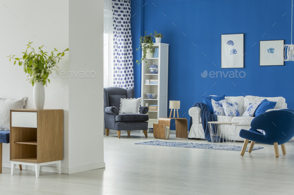 Spacious room with blue armchairs - Stock Photo - Images