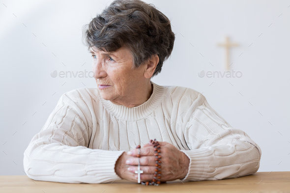 Religious grandmother with rosary - Stock Photo - Images